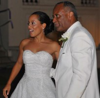 Essence Atkins with Father Geoffrey Atkins