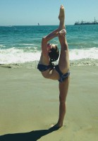 Kerris Dorsey doing Gymnastic pose on the beach in Bikini