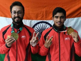 Saurabh Chaudhary with Abhishek Verma after winning Gold medal at the Asian Games 2018