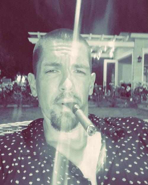 Steve Howey smoking a cigarette (or weed)