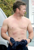 Topless Luke Hemsworth showing off his ripped body